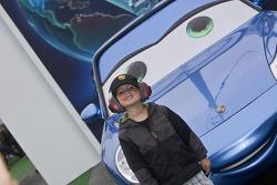 A young fan enjoying the Cars2 display