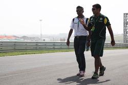 Karun Chandhok, test driver, Lotus F1 Team walks the track