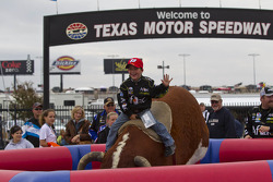 Fans try out the mechanical bull