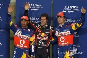 Pole winner Sebastian Vettel, Red Bull Racing, second place Lewis Hamilton, McLaren Mercedes, third place Jenson Button, McLaren Mercedes