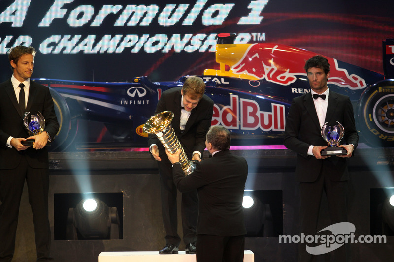 F1 champion Sebastian Vettel, second place Jenson Button, third place Mark Webber
