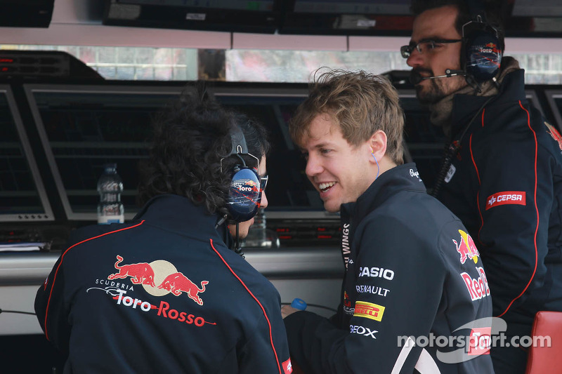 Sebastian Vettel, Red Bull Racing met voormalige Race engineer Laurent Mekies, Chief Engineer, Scuderia Toro Rosso