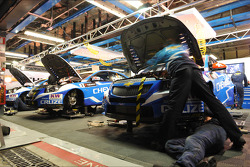 Mechanics work on the cars
