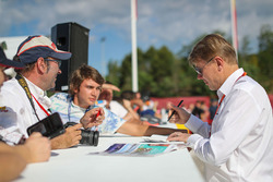 Mika Hakkinen, signs autographs for the fans