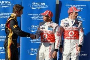 Pole winner Lewis Hamilton, McLaren Mercedes, second place Jenson Button, McLaren Mercedes, third place Romain Grosjean, Lotus Renault F1 Team