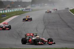 Lewis Hamilton, McLaren leads Jenson Button, McLaren