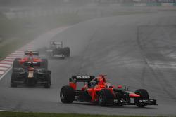 Timo Glock, Marussia F1 Team leads Heikki Kovalainen, Caterham F1 Team