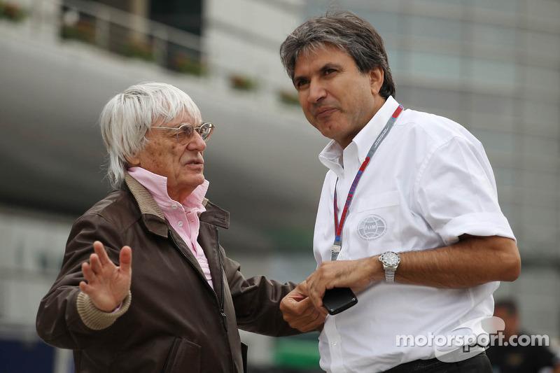 Bernie Ecclestone, CEO Formula One Group, with Pasquale Lattuneddu, of the FOM
