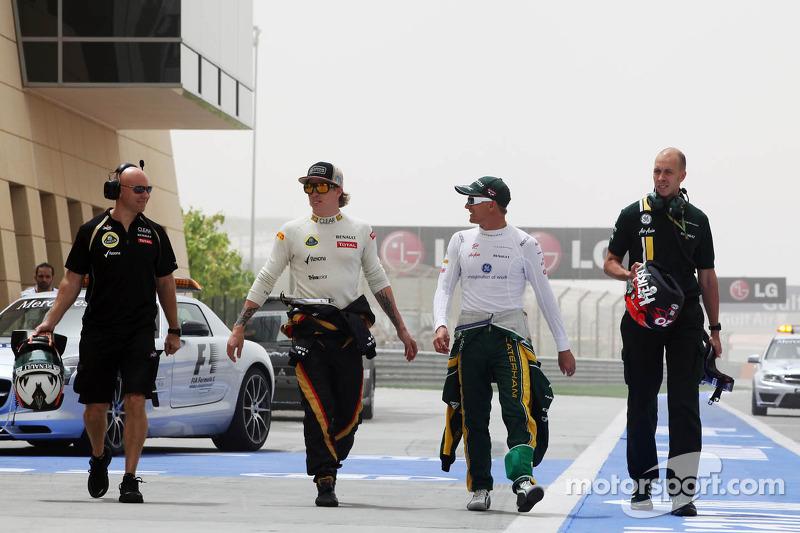 Kimi Raikkonen, Lotus F1 Team met Heikki Kovalainen, Caterham