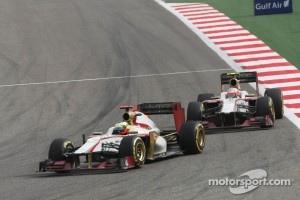 Pedro De La Rosa, HRT Formula 1 Team leads team mate Narain Karthikeyan, HRT Formula One Team HRT