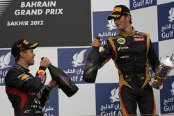 1st place Sebastian Vettel, Red Bull Racing and 3rd place Romain Grosjean, Lotus Renault F1 Team