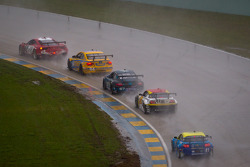 #69 AIM Autosport Team FXDD Racing with Ferrari Ferrari 458: Emil Assentato, Jeff Segal leads a group of cars