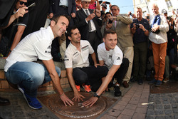 Porsche Team drivers Romain Dumas, Neel Jani, Marc Lieb with the 2016 winners hand print plaque