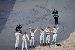 The Mercedes drivers salute the fans
