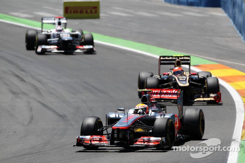 Lewis Hamilton, McLaren Mercedes leads Romain Grosjean, Lotus F1