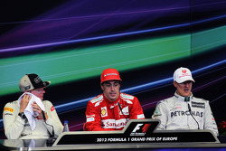 The post race FIA Press Conference Kimi Raikkonen, Lotus F1 Team, second; Fernando Alonso, Ferrari, race winner; Michael Schumacher, Mercedes AMG F1, third