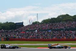 Nico Hulkenberg, Sahara Force India F1 leads Kamui Kobayashi, Sauber