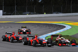 Pedro De La Rosa, HRT Formula 1 Team; Charles Pic, Marussia F1 Team and Timo Glock, Marussia F1 Team at the start of the race