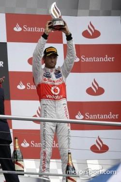 Jenson Button, McLaren celebrates his third position on the podium