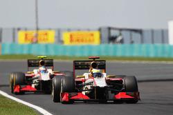 Pedro De La Rosa, HRT Formula 1 Team leads Narain Karthikeyan, HRT Formula One Team HRT