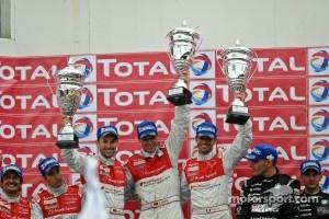 Overall podium: race winners Rene Rast, Frank Stippler, Andrea Piccini