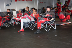 Mechanics watch the race