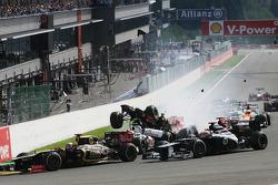 A crash at the start involving Lewis Hamilton, McLaren, Romain Grosjean, Lotus F1, Fernando Alonso, Ferrari, Kamui Kobayashi, Sauber