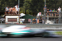 Michael Schumacher, Mercedes AMG F1 passes fans on makeshift grandstands