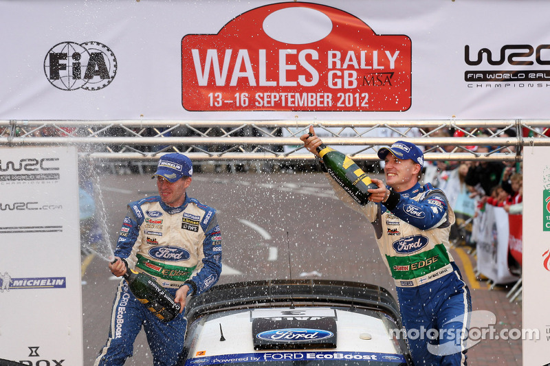 Podium: winners Jari-Matti Latvala and Miikka Anttila, Ford Fiesta RS WRC, Ford World Rally Team