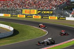 Kamui Kobayashi, Sauber leads Jenson Button, McLaren and Felipe Massa, Ferrari