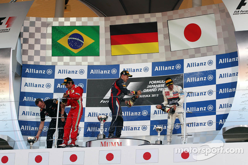 Eerste plaats Sebastian Vettel, Red Bull Racing, 2de Felipe Massa, Scuderia Ferrari en 3de Kamui Kobayashi, Sauber F1 Team