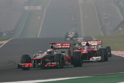 Jenson Button, McLaren leads Fernando Alonso, Ferrari