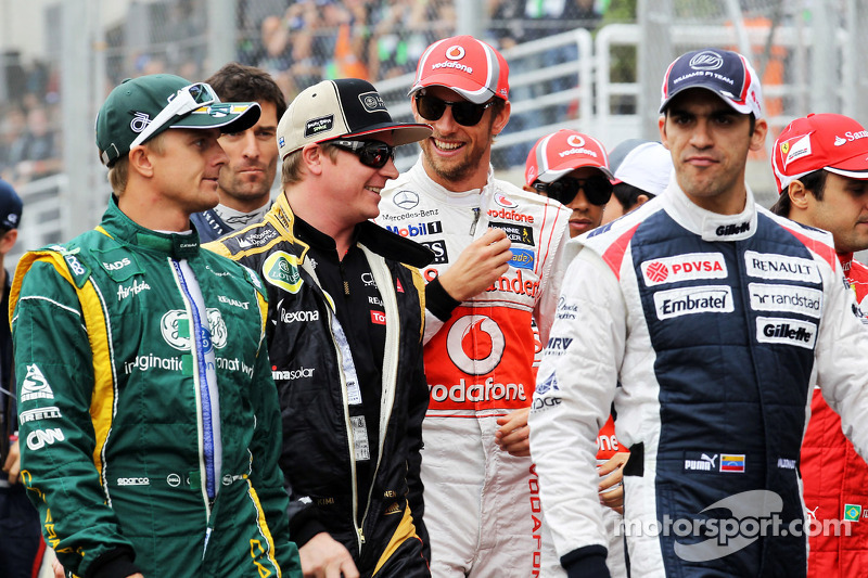 Heikki Kovalainen, Caterham, Kimi Raikkonen, Lotus F1 Team, Jenson Button, McLaren, Pastor Maldonado, Williams on the drivers parade
