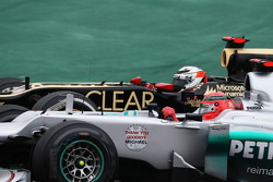 Michael Schumacher, Mercedes AMG F1 and Kimi Raikkonen, Lotus F1 battle for position