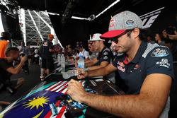 Carlos Sainz Jr., Scuderia Toro Rosso signs autographs for  the fans