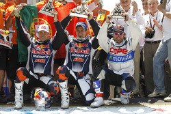 Bike winner Cyril Despres and second place Ruben Faria with third place Francisco Lopez