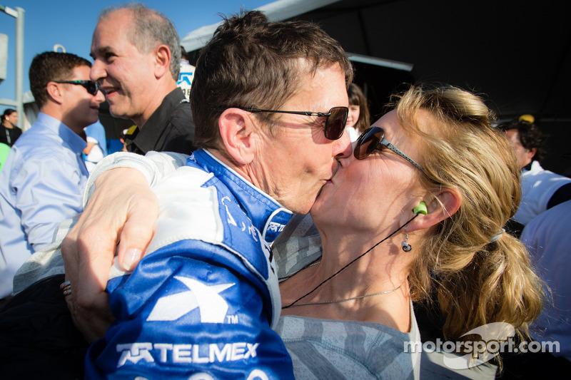 Race winner Scott Pruett celebrates with his wife
