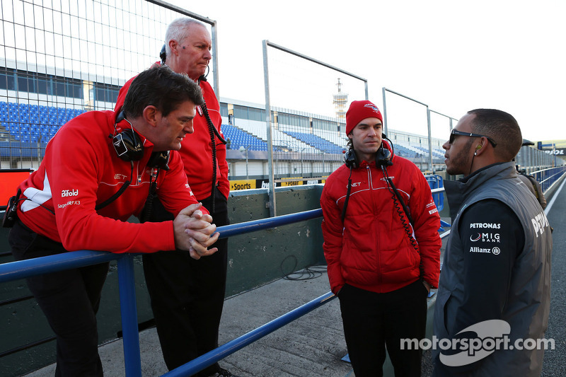 Lewis Hamilton, Mercedes AMG F1 with, Marussia F1 Team Chief Executive Officer, John Booth, Marussia F1 Team Team Principal and Marc Hynes, Marussia F1 Team Driver Coach
