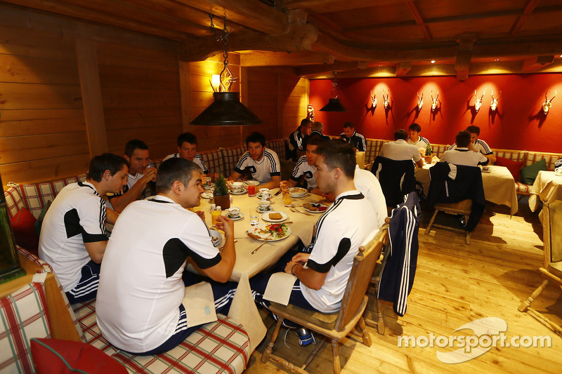 Drivers and team members at dinner