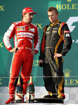 (L to R): Fernando Alonso, Ferrari on the podium