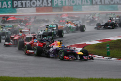 Sebastian Vettel, Red Bull Racing RB9 leads at the start of the race and is tagged by Fernando Alonso, Ferrari F138