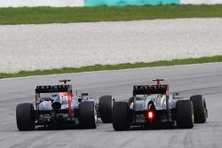Sebastian Vettel, Red Bull Racing RB9 and Romain Grosjean, Lotus F1 E21 battle for position