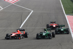 Jules Bianchi, Marussia F1 Team MR02 and Charles Pic, Caterham CT03 battle for position