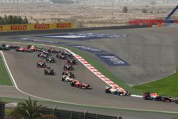 Sebastian Vettel, Red Bull Racing RB9 leads Paul di Resta, Sahara Force India VJM06 at the start of the race