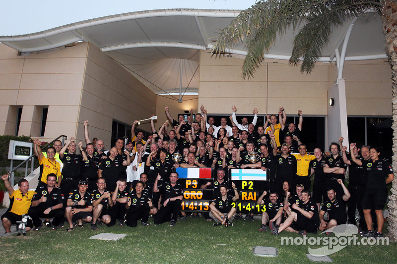 Kimi Raikkonen, Lotus F1 Team and Romain Grosjean, Lotus F1 Team celebrate second and third position with the team