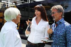(L to R): Bernie Ecclestone, CEO Formula One Group, with Suzi Perry, BBC F1 Presenter and Eddie Jordan, BBC Television Pundit