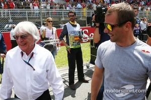 (L to R): Bernie Ecclestone, CEO Formula One Group, with Sebastien Loeb, Porsche AG on the grid