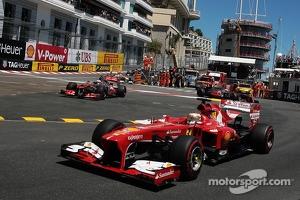 Fernando Alonso, Ferrari F138 passes through as Sergio Perez, McLaren MP4-28 runs wide at the chicane