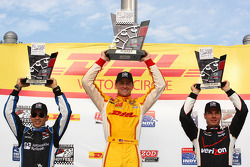 Race winner Ryan Hunter-Reay, second place Helio Castroneves, third place Will Power