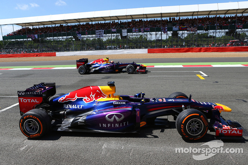 Sebastian Vettel Red Bull Racing car being passed by Mark Webber Red Bull Racing